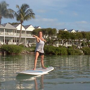 SUP Yoga or Stand Up Paddleboard Yoga