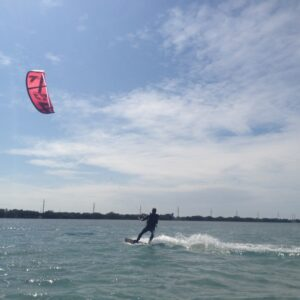 Kiteboarding in the calm clear waters, Aaron Osters